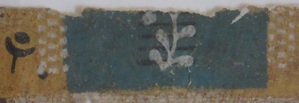 Detail of a plant sprig on a fragment of wallpaper from the Morris-Jumel Mansion.