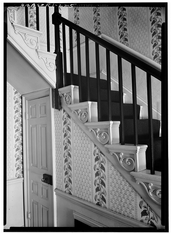 Stair hall of the William L. Brown House in Providence, Rhode Island, hung with morning-glory wallpaper.