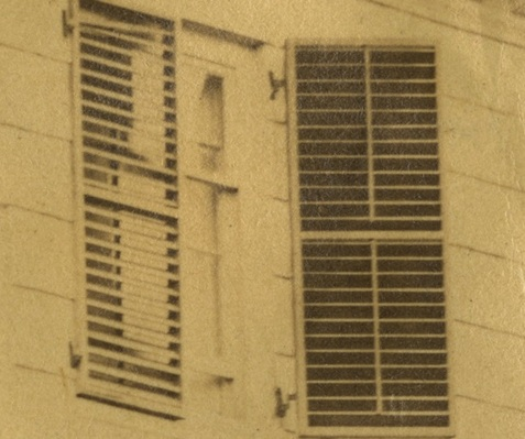 Detail of a photograph of the Morris-Jumel Mansion showing a pair of venetian blinds in a window circa 1860.