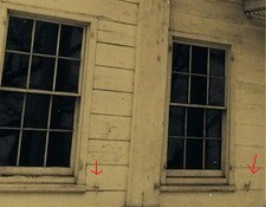Photograph of the exterior of the Morris-Jumel Mansion showing shutter dogs (also called shutter holdbacks) used to hold window shutters open.