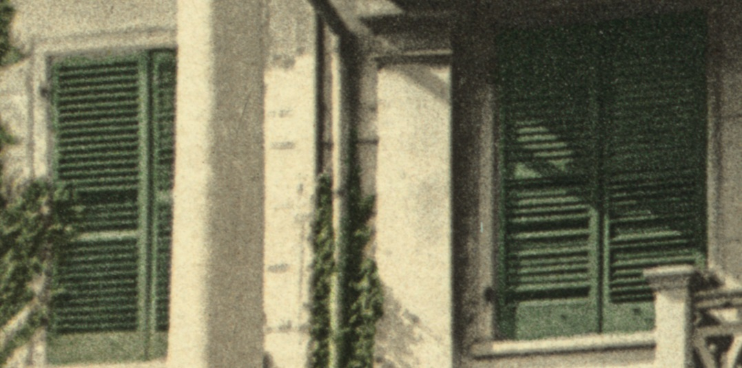 Detail of a postcard showing two windows of the Morris-Jumel Mansion with venetian blinds in 1903.