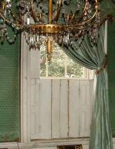 Photograph of the lower shutters of a parlor window in the Morris-Jumel Mansion, shown in closed position.